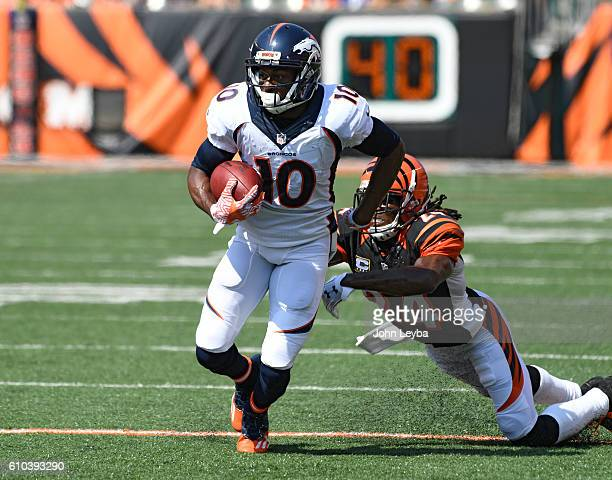 Denver Broncos wide receiver Emmanuel Sanders breaks a tackle by Cincinnati Bengals cornerback Adam Jones during the first quarter September 25 2016...