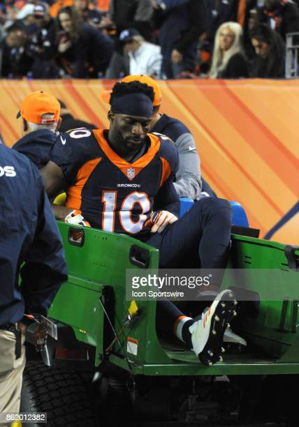 Denver Broncos wide receiver Emmanuel Sanders is carted off the field after an injury during a game between the New York Giants and the Denver...