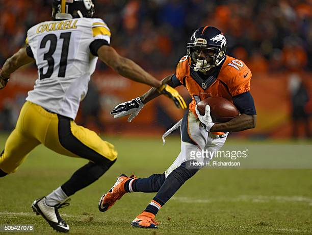 Denver Broncos wide receiver Emmanuel Sanders picks up some yards as Pittsburgh Steelers defensive back Ross Cockrell moves in on the play during the...