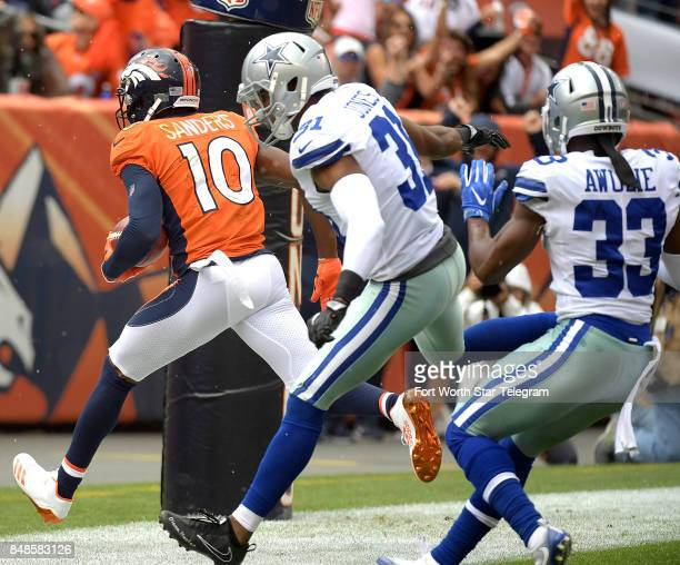 Denver Broncos wide receiver Emmanuel Sanders scores a touchdown in front of Dallas Cowboys free safety Byron Jones and cornerback Chidobe Awuzie...