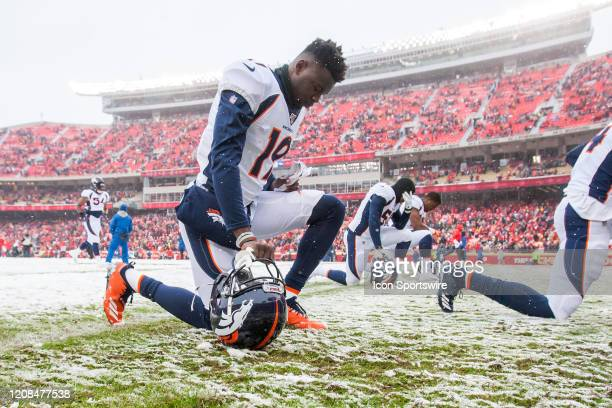 Denver Broncos wide receiver Fred Brown takes a knee in prayer with his teammates prior to the game between the Denver Broncos and the Kansas City...