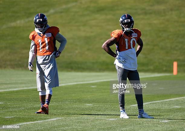 Denver Broncos wide receiver Jordan Norwood and Denver Broncos wide receiver Emmanuel Sanders watch drills during practice October 20 2016 at Dove...