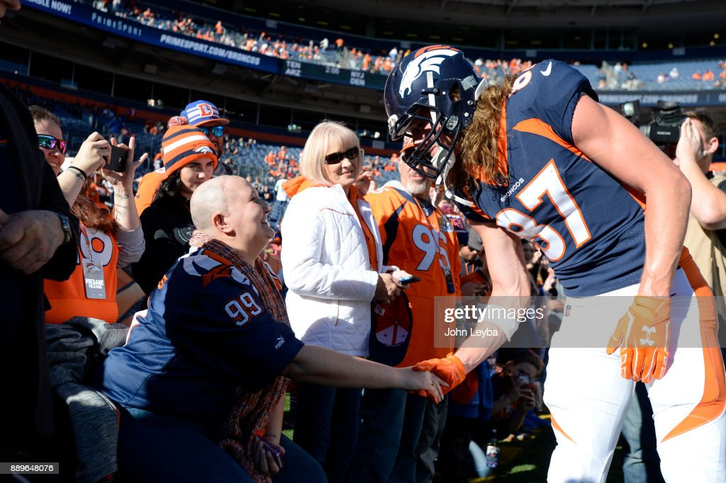 Denver Broncos wide receiver Jordan Taylor (87) meets with Katina Buerger 37-years-old from Loveland during pregame prior to the game agains the New York Jets on December 10, 2017 in Denver, Colorado at Sports Authority Field at Mile High Stadium.