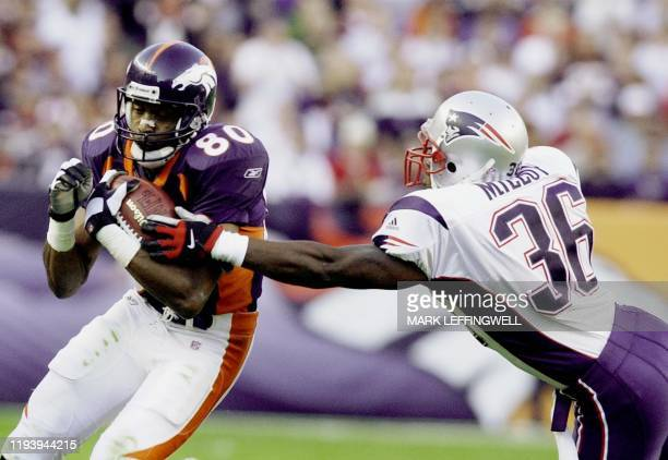 Denver Broncos' wide receiver Rod Smith breaks away from New England Patriots Lawyer Milloy and gains 16 yards on a reception setting the Broncos up...