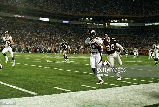 Denver Broncos wide receiver Rod Smith runs with the football after making a catch during the Broncos 3419 victory over the Atlanta Falcons in Super...