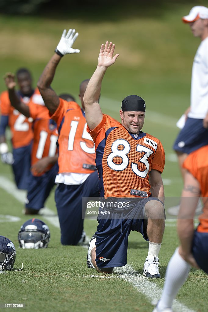 Denver Broncos wide receiver Wes Welker (83) stretches during practice August 22, 2013 at Dove Valley