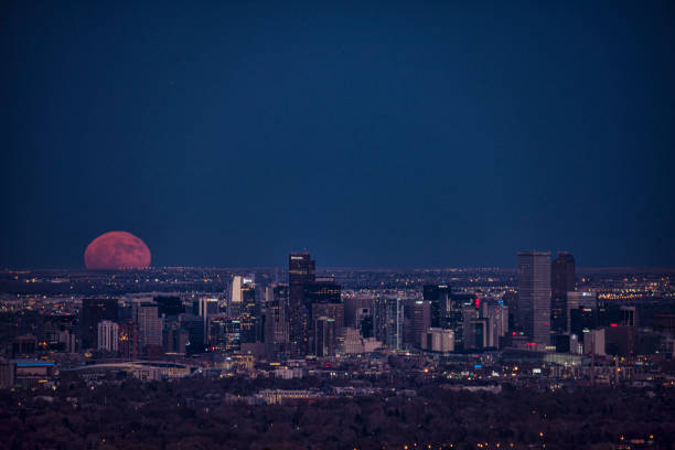 Denver cityscape full moon rise