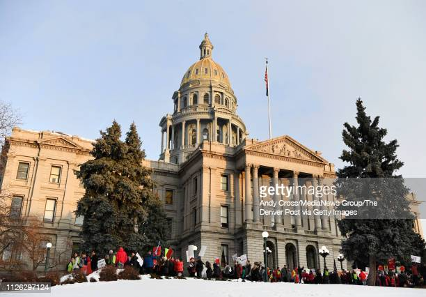 Denver Classroom Teachers Association teachers and supporters march from the Colorado State Capitol to the Denver Public Schools headquarters...