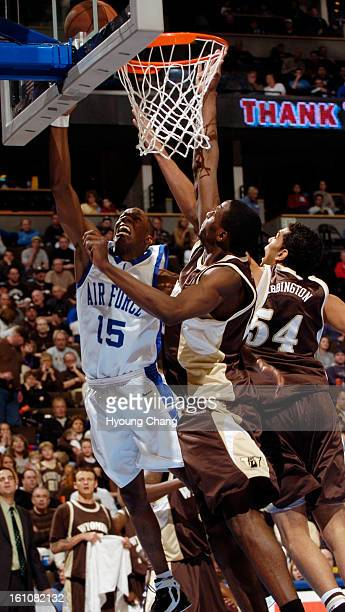 Denver CO March 9 2006 Air Force Academy Antoine Hood 's shot blocked by Wyoming Justin Williams center and Derek Wabbington in the 1st half of the...