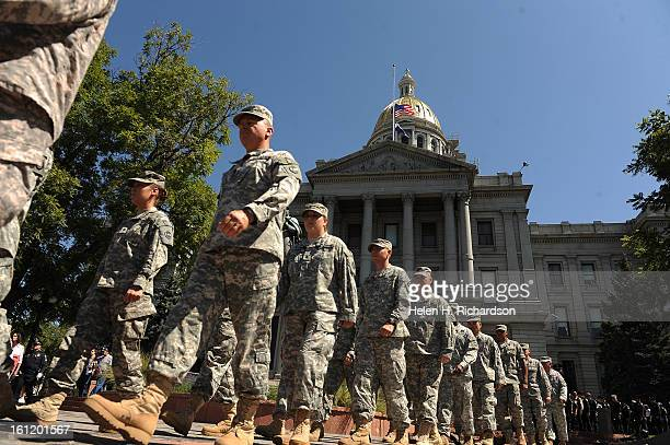 Denver CO September 11 2011 Members of the Colorado National Guard Honor Guard lead the procession from the state capitol to Civic Center Park The...