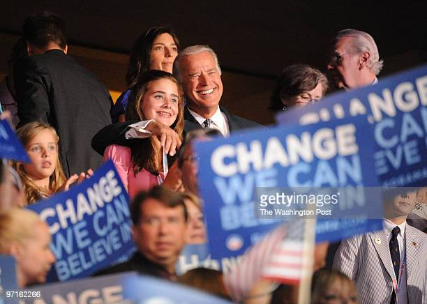 Denver CO The opening night of the DNCSenator Joe Biden with his arm around the neck of Naomi one of his granddaughters