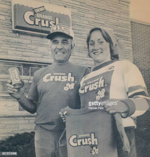Denver Colo Oct 28Orange Crush Joe Iacino President of a Denver soft drink distributor and granddaughter Karen Scheitler pose with some of the...