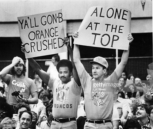 DEC 4 1977 DEC 5 1977 OCT 29 1984 Denver Colo/Special Transmission for Kansas City StatBronco fans in Houston hold up supportive cards Post 1977...