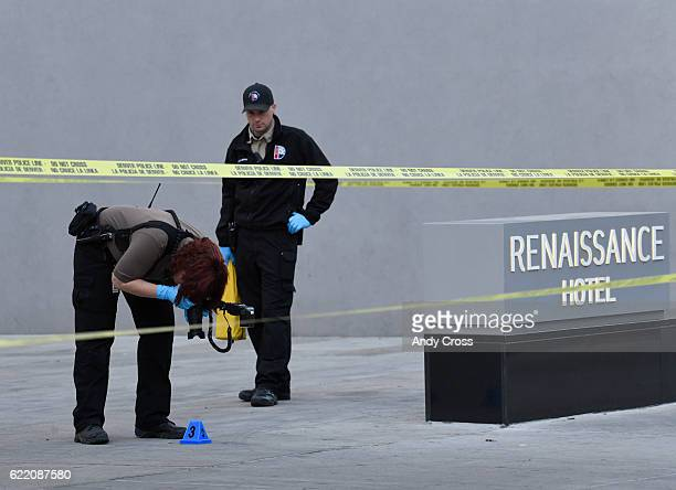 Denver crime scene investigators mark and photograph evidence at a shooting crime scene on Champa St between and 16th and 17th Ave in the Renaissance...
