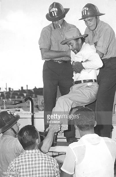 JUL 6 1955 JUL 8 1955 Denver Crippled with arthritis bearded Eloy Maes is helped by firemen Vern Hansen and Tad Hannigan from the 25foot platform on...