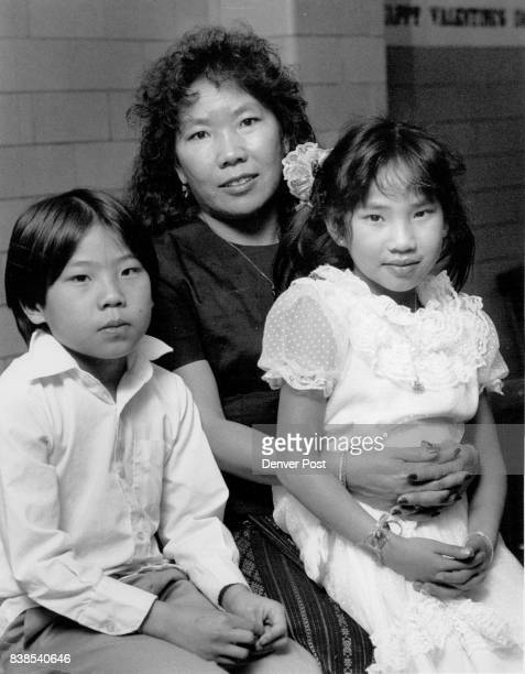 Denver Family Literacy Program Chao Lor With Son Yuexa Lee 9 and Daughter Cindi Lee 7 Credit The Denver Post