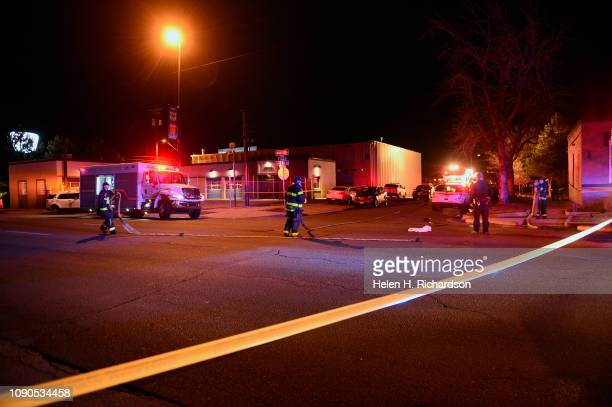 Denver Fire Department helps clean up the scene of an officerinvolved shooting on the edge of Denver's Lincoln Park neighborhood on January 27 2019...