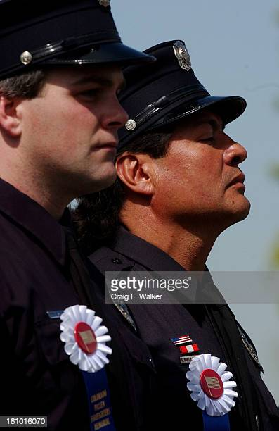 Denver Fire fighters Don Patterson and Ron Garcia of Fire Station 9 stand for the Invocation during the Colorado Fallen Fire Fighter Memorial...