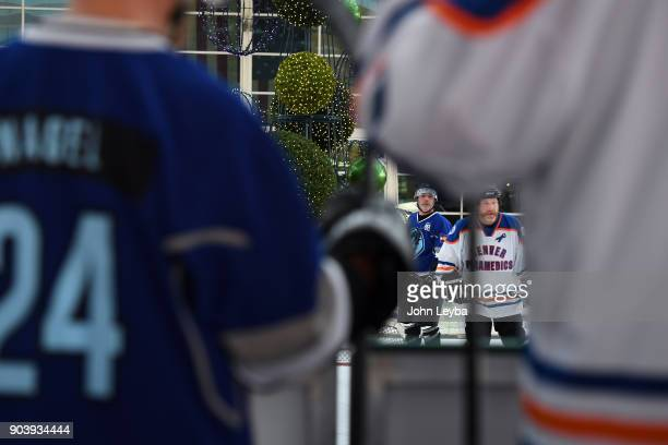 Denver first responders and employees of Denver International Airport swapped their uniforms for hockey sweaters and skates to face off in a...