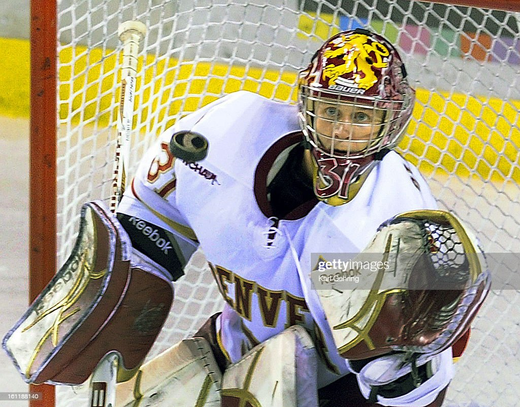 Denver goalie Juho Olkinuora made a glove save in the third period Saturday. The University of Denver hockey team was shut out 4-0 by Minnesota Duluth at Magness Arena Saturday night November 5, 2011. Karl Gehring,The Denver Post : News Photo