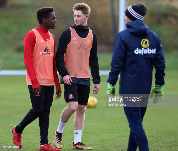 Denver Hume chats with Joel Asoro during a Sunderland training session at The Academy of Light on December 13 2017 in Sunderland England