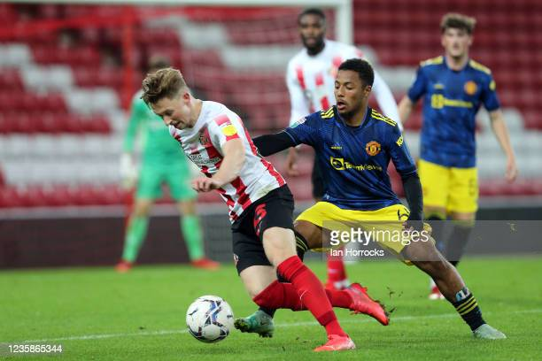 Denver Hume of Sunderland carries the ball during the Papa John's Trophy match between Sunderland and Manchester United at Stadium of Light on...