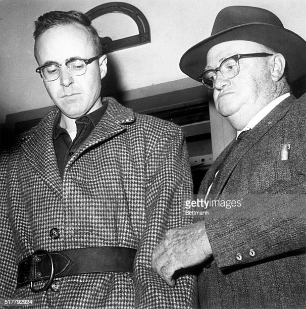 Joseph Corbett Jr suspect in the kidnapslaying February 9 1960 of Colorado brewer Adolph Coors III is taken into custody by Captain Charles Morris of...