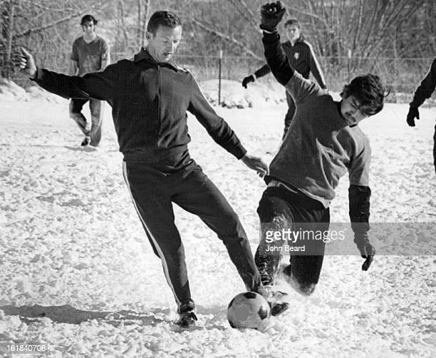 FEB 5 1971 FEB 15 1971 FEB 17 1971 Denver Kickers works out Despite snow and Subfreezing Weather Scrimmaging are Adam Bender left and Billy...