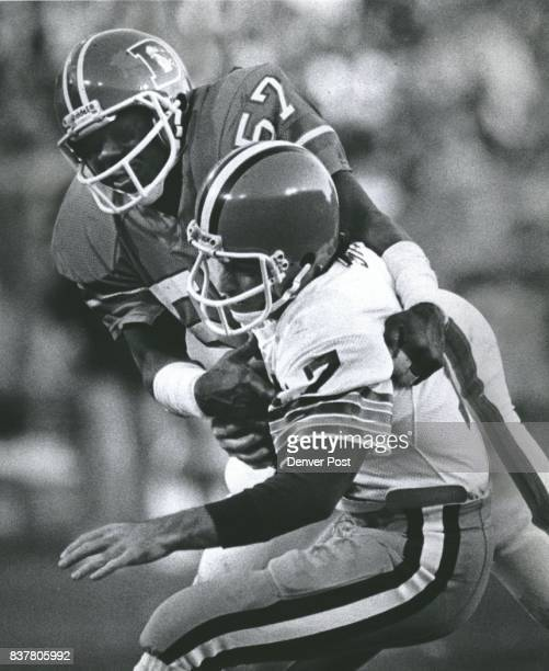 Denver linebacker Tommy Jackson grabs Cleveland quarterback Brian Sipe for a sack Credit The Denver Post