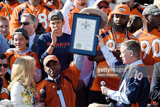 Denver Mayor Michael B Hancock and governor John Hickenlooper hold a joint proclamation making the day Pat Bowlen day as his wife Annabel Bowlen...