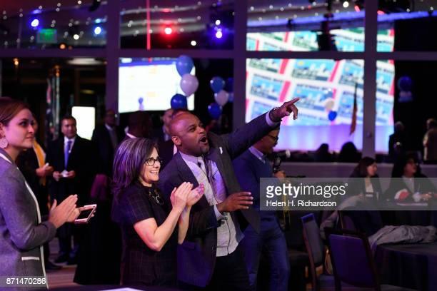 DENVER CO NOVEMBER 7 Denver Mayor Michael Hancock cheers the positive returns on the television screen for the passing of Denver's $937 million bond...