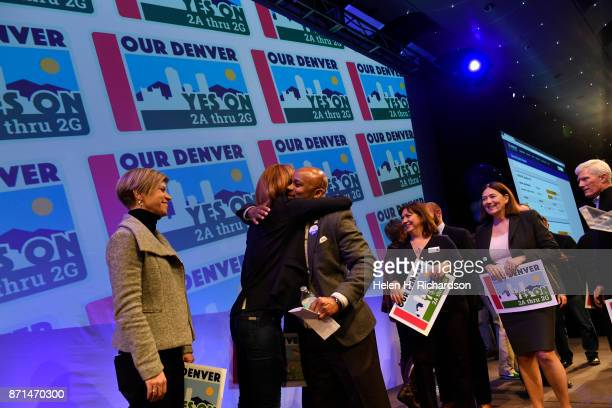 DENVER CO NOVEMBER 7 Denver Mayor Michael Hancock hugs Andrea Fulton of the Denver Art Museum after celebrates with bond supporters the passing of...