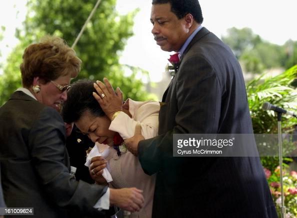 Denver Mayor Wellington Webb comforts his wife Denver ...