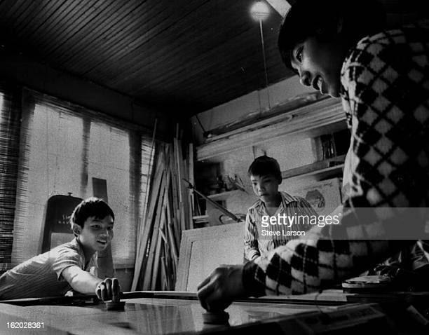 OCT 29 1975 NOV 2 1975 Denver Newcomers Nguyen Van Toan right who arrived in Denver a week ago with his family discusses his flight from Saigon last...