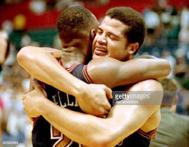 Denver Nuggets Brian Williams hugs teammate LaPonson Ellis after Denver beat the Seattle SuperSonics 98-94 in overtime action 07 May in Seattle. The...
