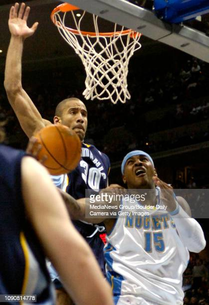 Denver Nuggets Carmelo Anthony is fouled by Memphis Grizzlies Dahntay Jones while going up for a shot during the second half of their NBA game in...