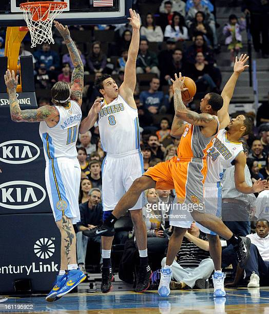 Denver Nuggets center Chris Andersen , forward Danilo Gallinari and point guard Andre Miller attempt to block a shot by Phoenix Suns point guard...