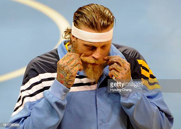 Denver Nuggets center Chris Andersen twisting up his handlebar mustache before the start of game 4 of the first round of the NBA playoffs Sunday May...