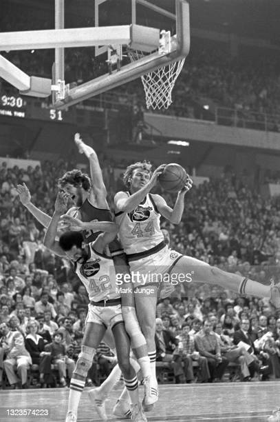 Denver Nuggets center Dan Issel grabs a rebound under the basket during an NBA basketball game at McNichols Arena on January 26, 1977 in Denver,...