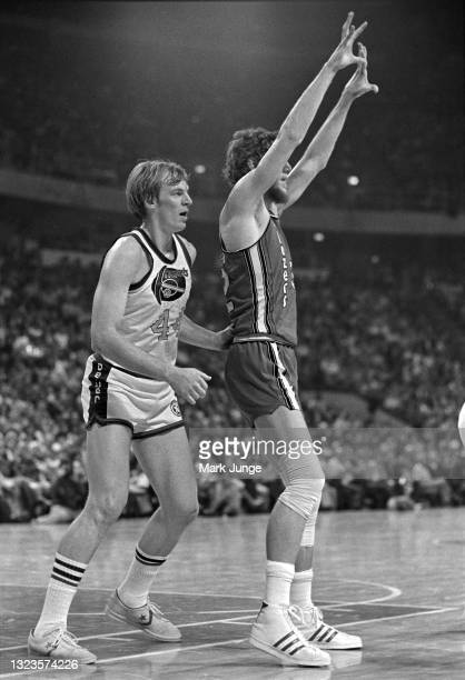 Denver Nuggets center Dan Issel guards Portland Trail Blazers center Bill Walton during an NBA basketball game at McNichols Arena on January 26, 1977...