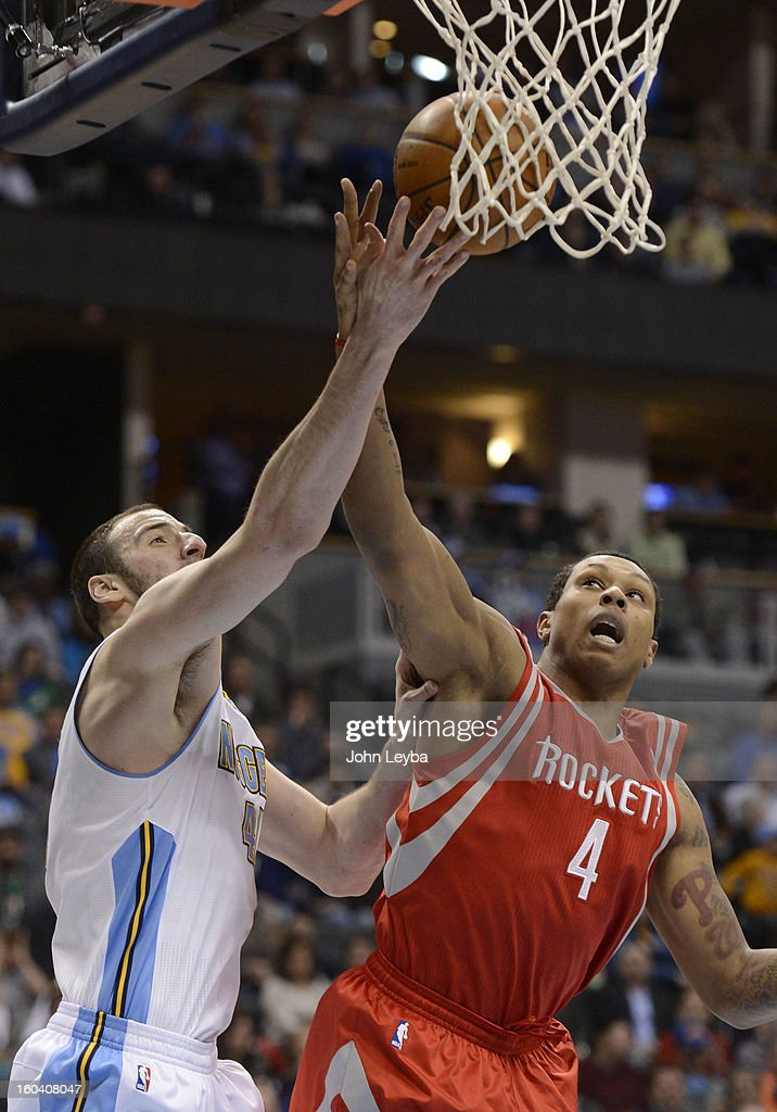 Denver Nuggets center Kosta Koufos (41) battles for a rebound with Houston Rockets power forward Greg Smith (4) during the second quarter January 30, 2013 at Pepsi Center. The Denver Nuggets take on the Houston Rockets in NBA action.