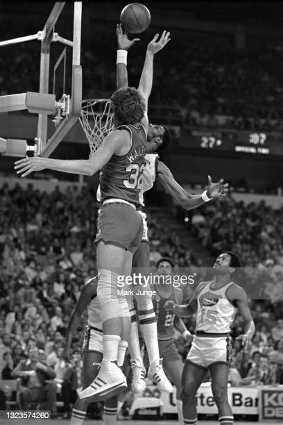 Denver Nuggets center Marvin Webster blocks a shot by Portland Trail Blazers center Bill Walton during an NBA basketball game at McNichols Arena on...