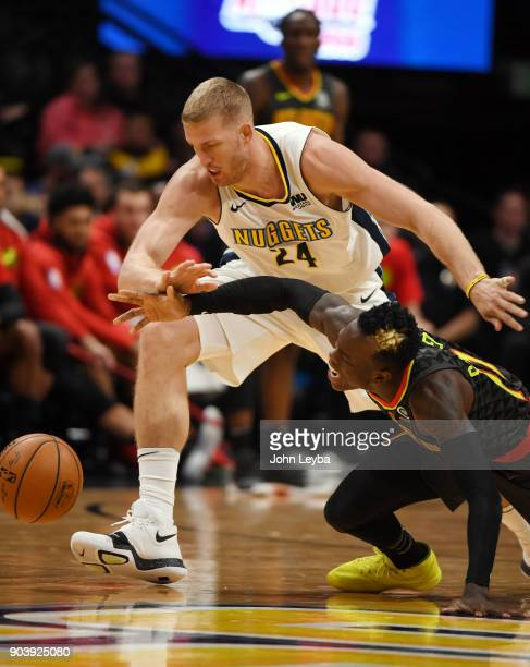Denver Nuggets center Mason Plumlee and Atlanta Hawks guard Dennis Schroder chase after a loose ball during the fourth quarter on January 10 2018 at...