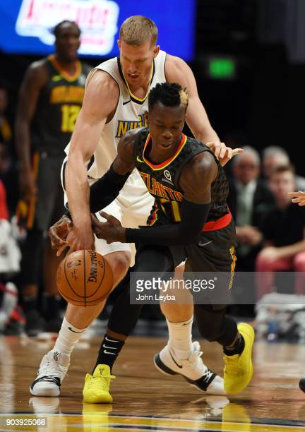 Denver Nuggets center Mason Plumlee reaches in on Atlanta Hawks guard Dennis Schroder to knock the ball away on January 10 2018 at Pepsi Center