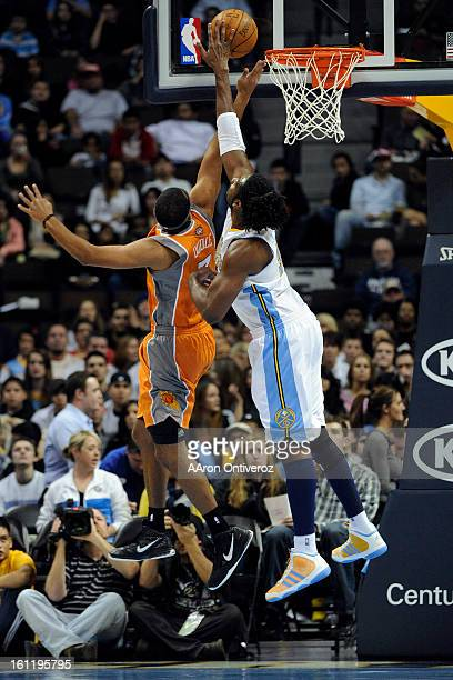Denver Nuggets center Nene Hilario blocks Phoenix Suns small forward Jared Dudley at the Pepsi Center on Tuesday December 20 2011 AAron Ontiveroz The...