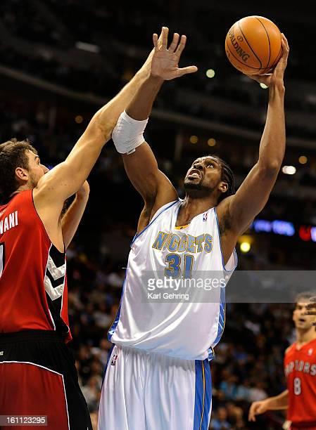 Denver Nuggets center Nene Hilario shoots over Toronto Raptors center Andrea Bargnani in the first half The Denver Nuggets hosted the Toronto Raptors...