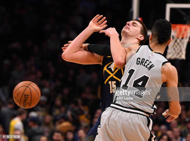Denver Nuggets center Nikola Jokic gets fouled by San Antonio Spurs guard Danny Green during the fourth quarter on February 13 2018 at Pepsi Center