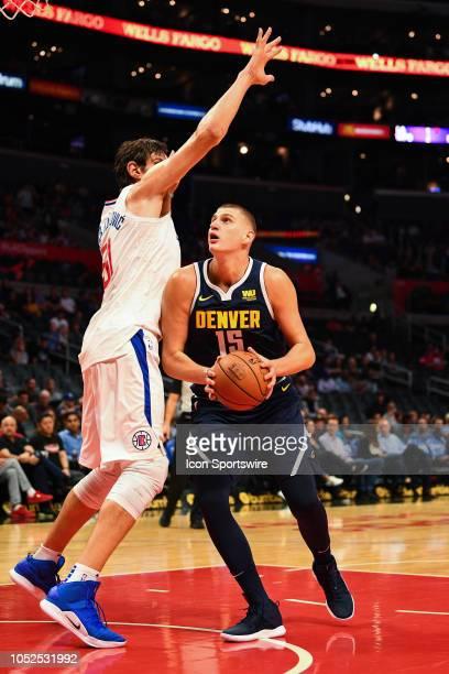 Denver Nuggets Center Nikola Jokic looks to score on Los Angeles Clippers Center Boban Marjanovic during an NBA preseason game between the Denver...