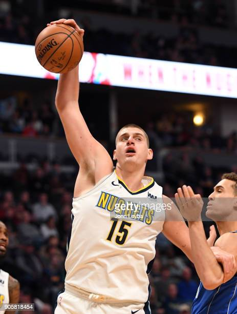 Denver Nuggets center Nikola Jokic pulls down a rebound from Dallas Mavericks forward Dwight Powell during the fourth quarter on January 16 2018 at...