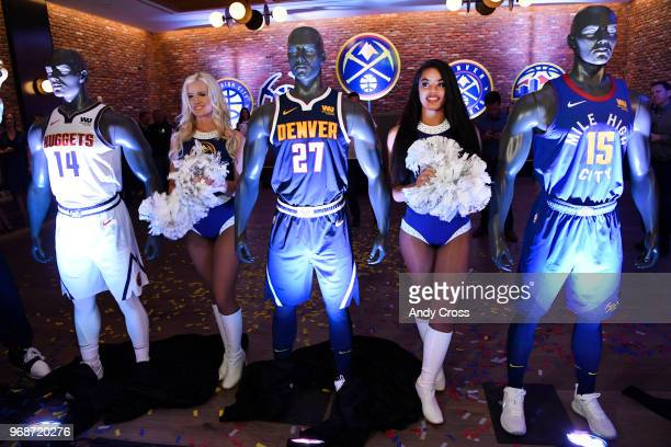 Denver Nuggets dancers Ashley left and Hannah help to unveil the Denver Nuggets new uniforms and logos at the Evolve VIP party at the Dairy Block in...